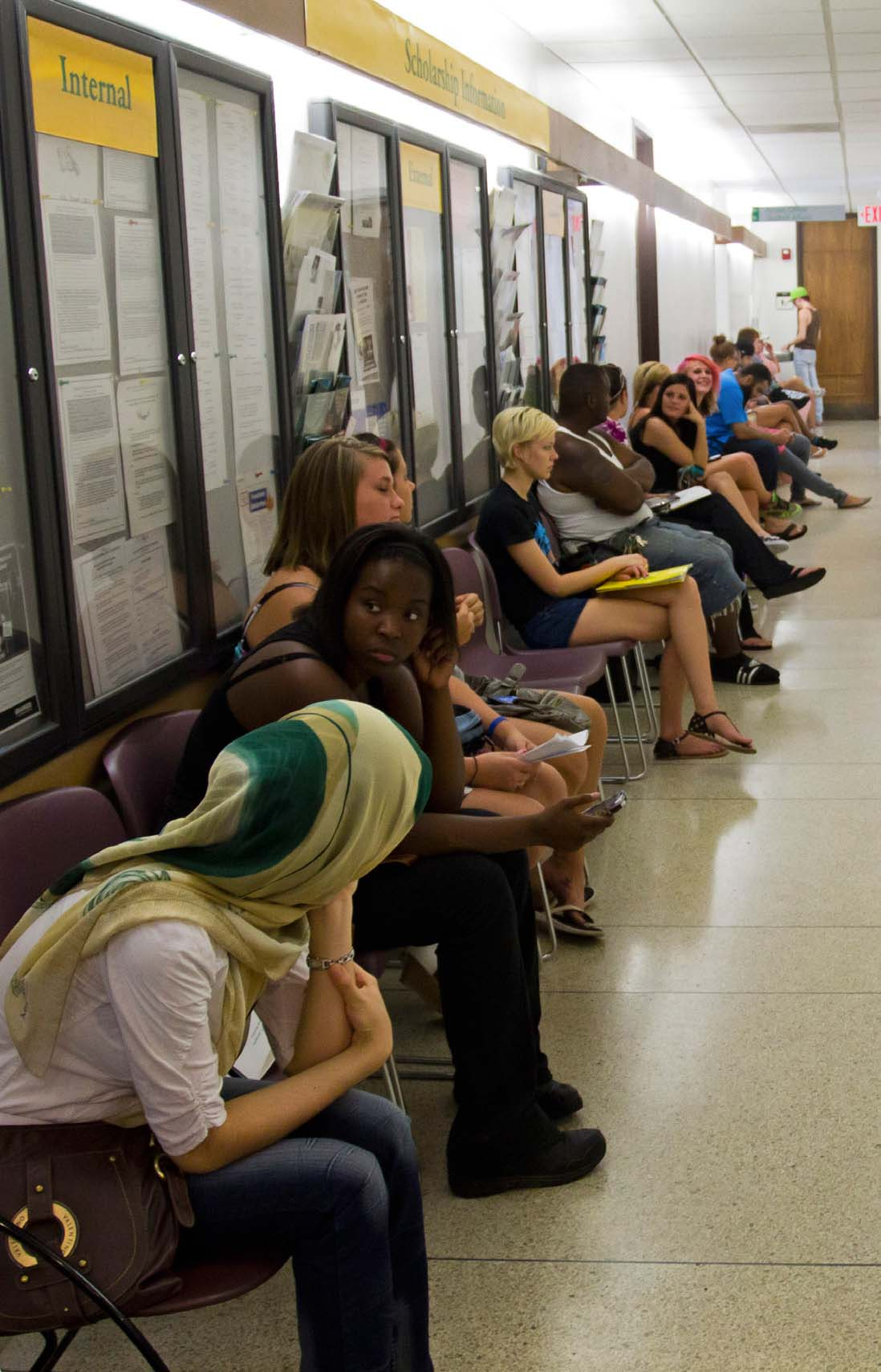 Students wait in line for financial aid in the hallway just outside the financial aid office on the first floor of Clark Hall. The line extended so far that it overflowed down the hallway and into the backrooms. Photo | Hans Steiner