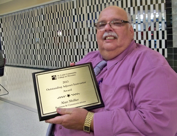 Meramec adjunct instructo Alan Shiller holds his award for Outstanding Adjunct Award in May 2013. Shiller taught at Meramec for 27 years and in a 40 year career, Shiller taught more than 10,000 students. Shiller, who also taught at Webster University and Southwest Illinois University-Edwardsville, would teach 10 to 14 classes a semester between three and four colleges.