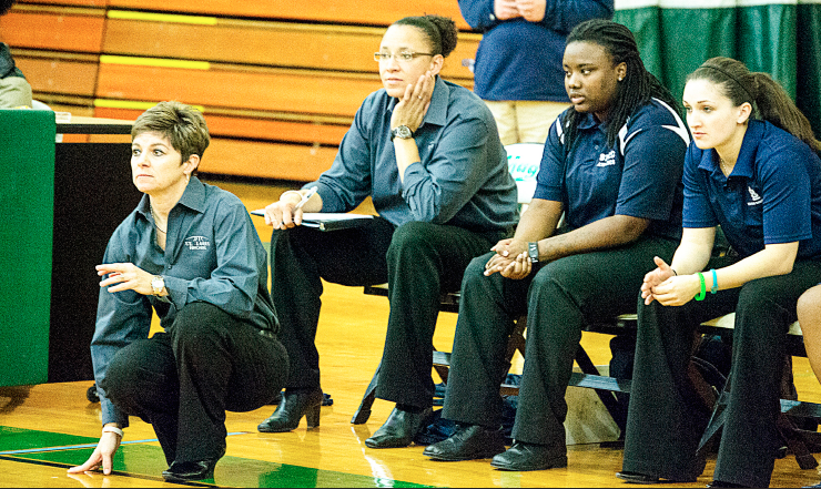 From Left to Right: Lady Archers Head Coach Shelly Ethridge, Assistant Coaches Melanie Marcy, Lemetrius Jackson and Janey Milligan look on during the Archers' game against the Penn Valley Scouts on Jan. 22 at Meramec. Jackson and Milligan played for Ethridge and Marcy during 2010-11 Meramec Magic season. PHOTO | DAVID KLOECKENER