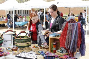 Sammie Piper (left) and Sammi Constantin (right), Meramec students, look at a booth during the Earth Day celebration hosted Wednesday April 23.