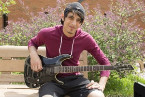 Giuseppe Abbate, Meramec student, uses music to help cope with what has happened in his life. He recently played for his largest audience, a classroom of about 15 students.