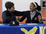 Khalia Miller shakes Ethridge's hand after signing STLCC papers on April 9. | PHOTO: SPENCER GLEASON