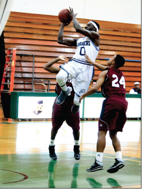 STLCC freshman guard Marcus Lampley (0) jumps through opposing players to go for a lay-up against Wentworth Military College on Feb. 28, 2014. The Archers defeated Wentworth, 72-67. | PHOTO: DAVID KLOECKENER
