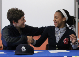 Khalia Miller shakes Ethridge's hand after signing STLCC papers on April 9, 2014.