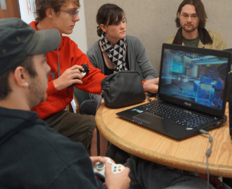 Students gather in the Humanities East building to play video and computer games between classes. PHOTO | KAYLA CACCIATORE