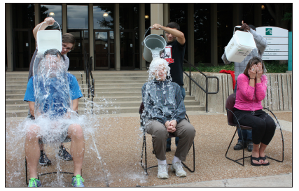 STLCC - Meramec President Pam McIntyre (center) accepts the ALS Ice Bucket Challenge, along with Vice President of Academic Affairs Andrew Langrehr (left) and Vice President of Student Affairs Kim Fitzgerald (right.) They were challenged by TRiO, the student support service program, on Oct. 8. PHOTO | SPENCER GLEASON