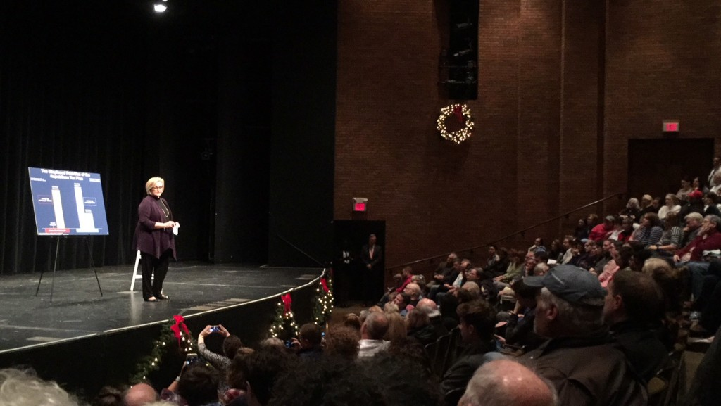 """Democratic Senator Claire McCaskill uses a chart to explain the effects of the Republican tax bill at a town hall meeting hosted in Meramec's theater on Dec. 16. McCaskill, a Kirkwood native, offered scathing criticism for the bill and promoted bipartisan decisions going forward, announcing she """"would love to"""" seek reelection in the future. This was McCaskill's 50th town hall meeting. PHOTO: TONIA ROBIN"""
